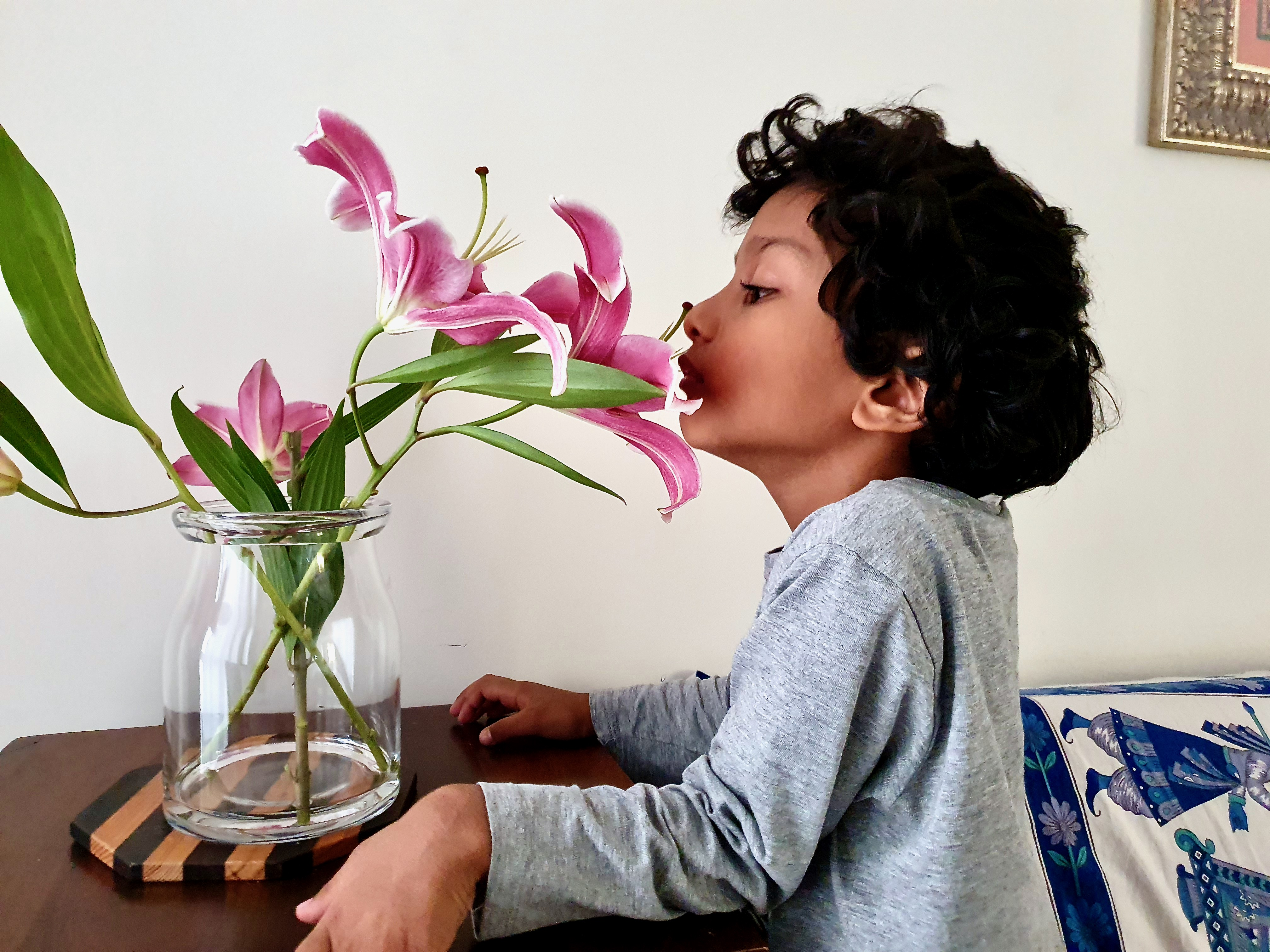 Child smelling lillies