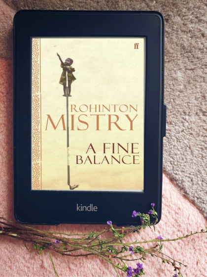 kindle paperwhite with the cover of Rohinton Mistry's A Fine Balance