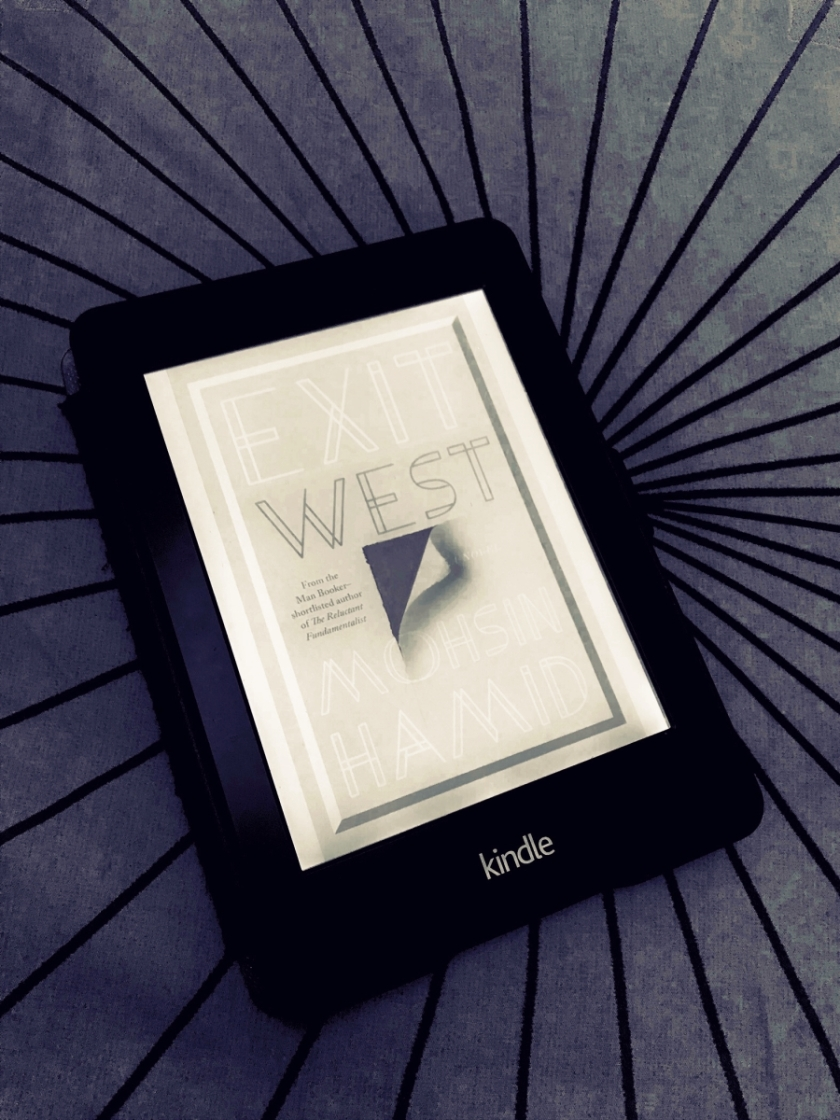 Kindle Paperwhite ebook reader with the cover of Exit West by Mohsin Hamid