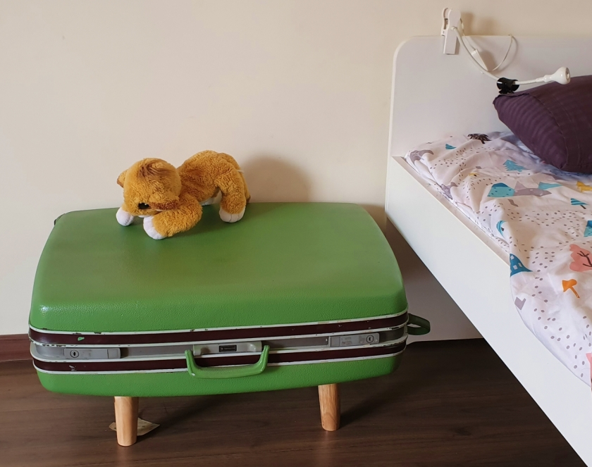 Old suitcase up-cycled to a bedside table with storage