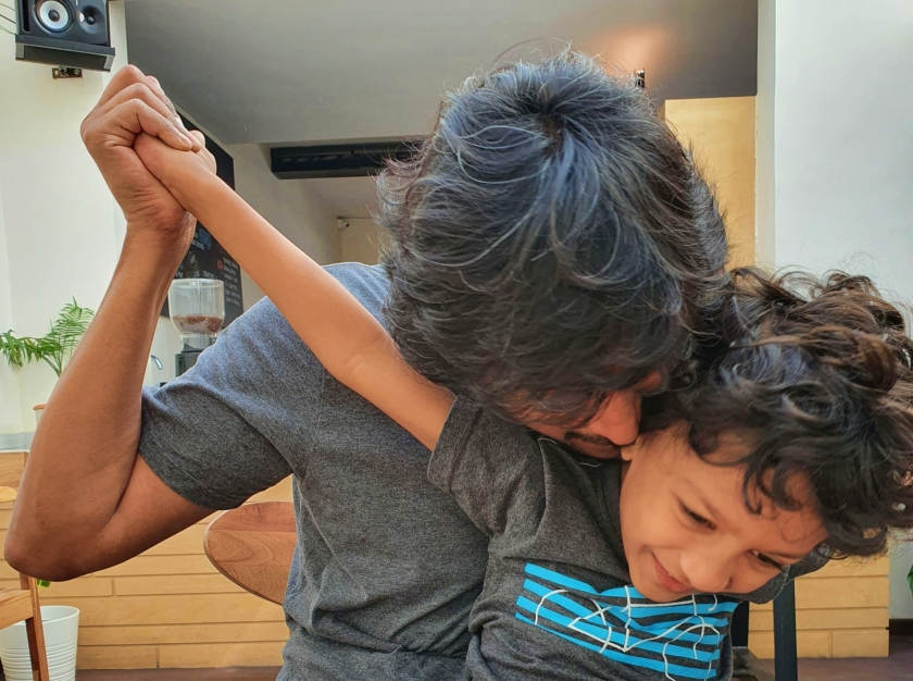 father and son in playful embrace