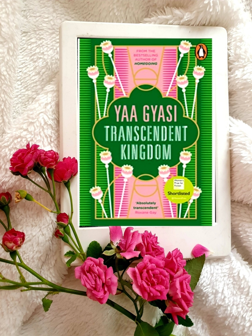 Kindle cover of Transcendent Kingdom by Yaa Gyasi with a bunch of pink roses on a white fabric
