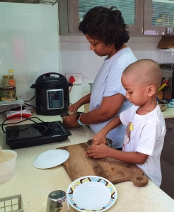 Child learning to make ro