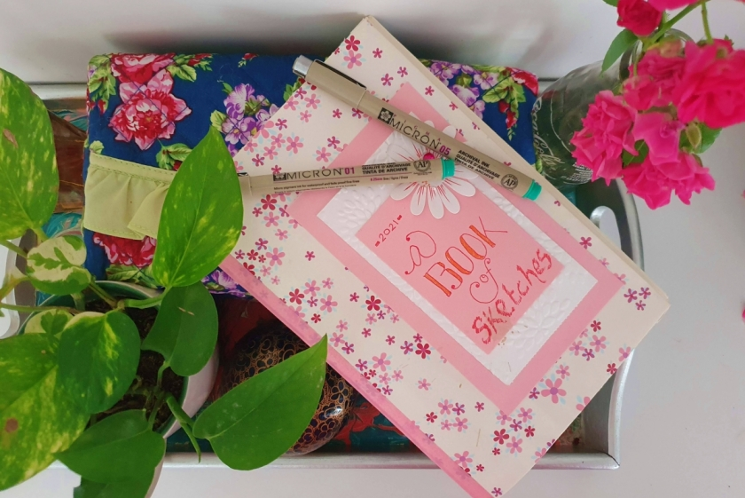 diy bookbinding sketchbook with house plants and fine liner pens