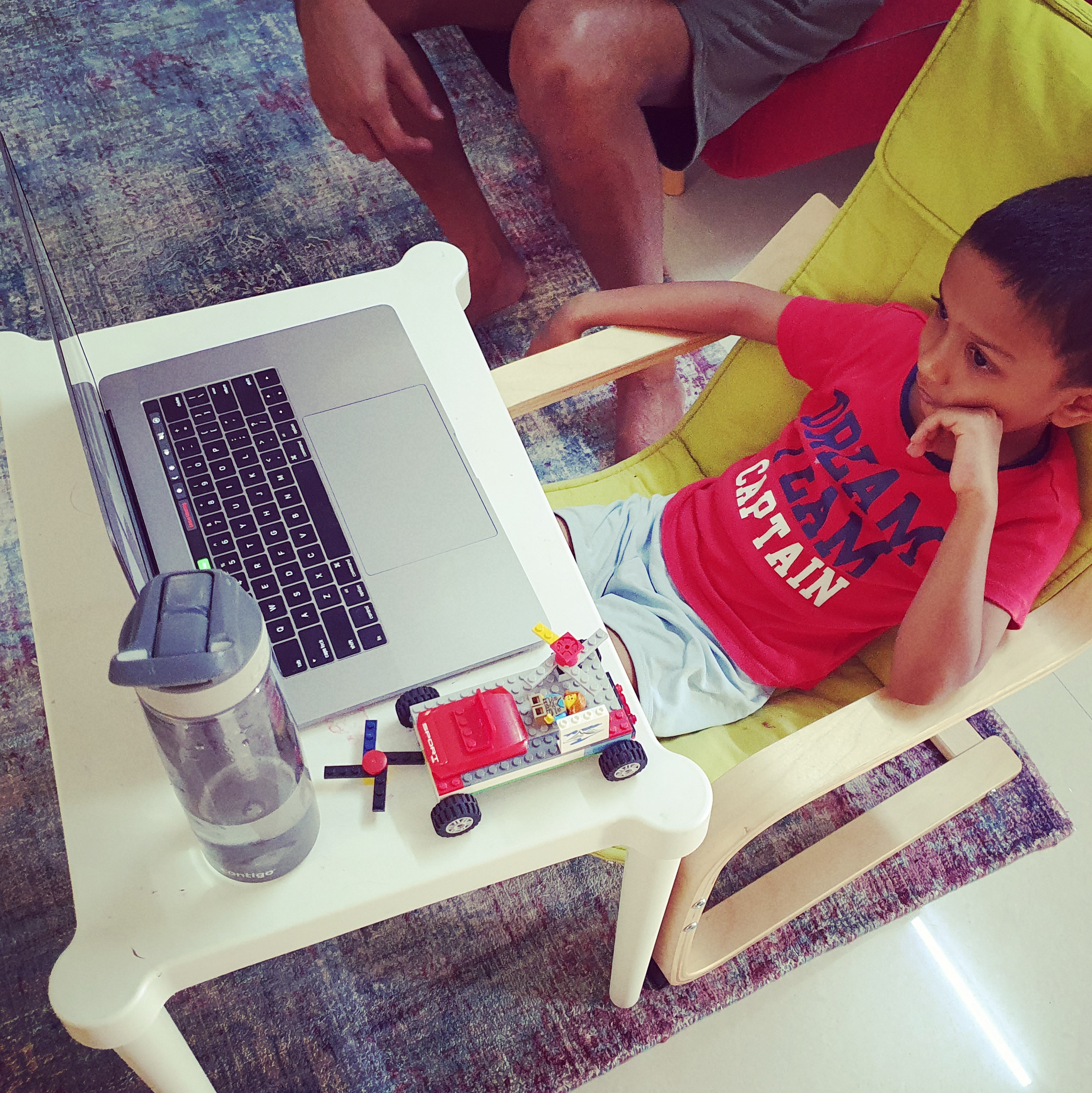 Child in front of a laptop attending online school