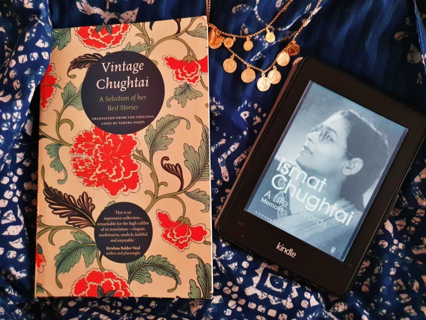 Books by Ismat Chughtai on a blue backdrop with a gold necklace