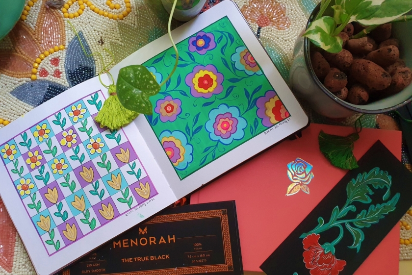 Art journals from Menorah Stationery displayed with cover and inside pages with paintings
