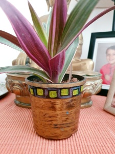 Plastic pot painted with markers