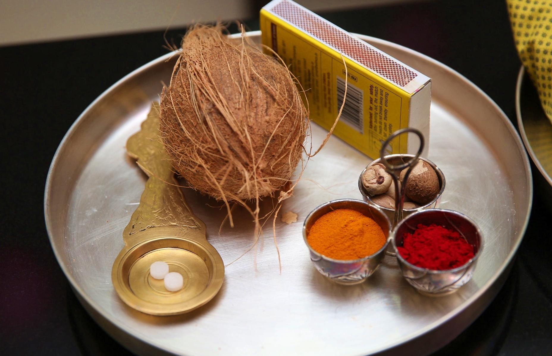 Prayer plate with coconut, camphor, matchbox, and haldi kumkum
