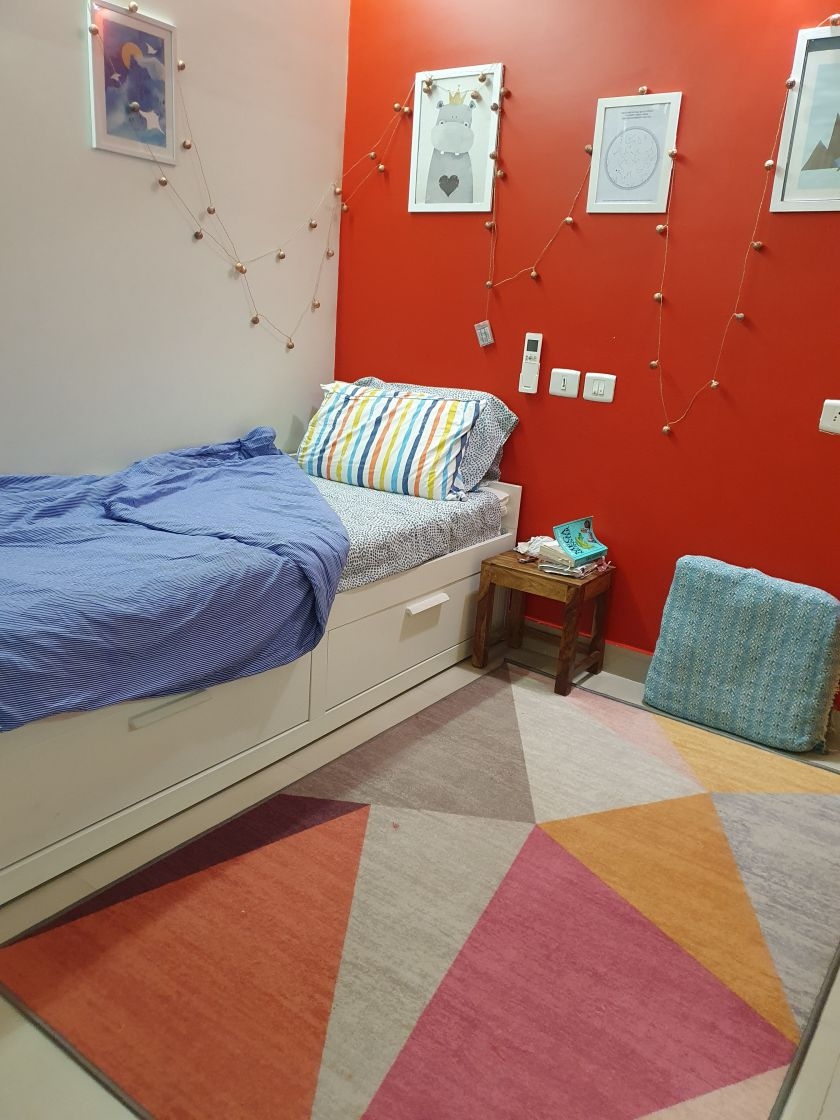 kids bedroom with red walls