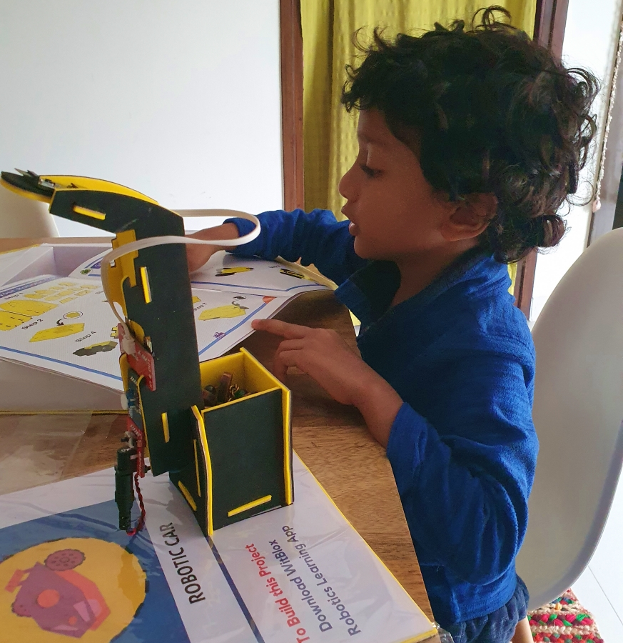child making a robotic set