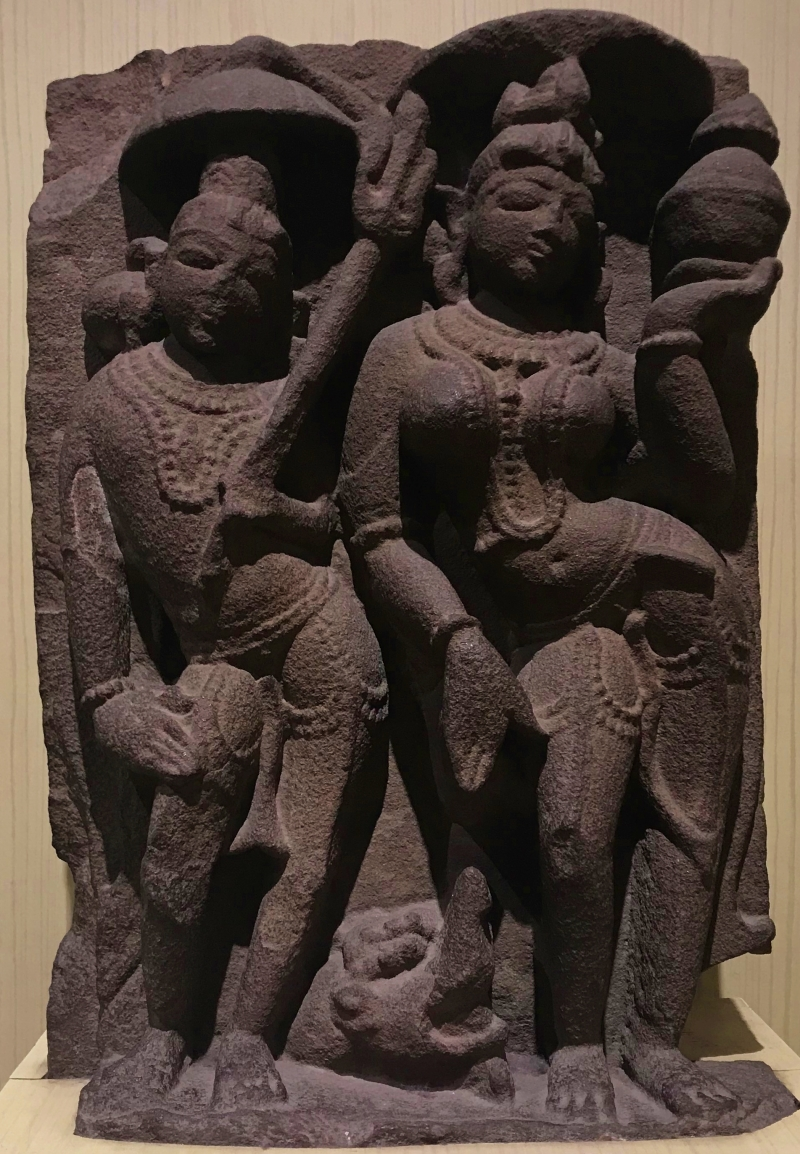 ancient stone carving of 2 women from india displayed at the salar jung museum