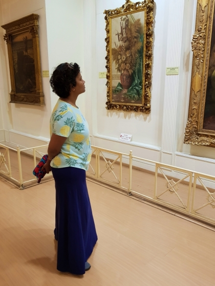 woman looking at the paintings gallery at salar jung museum hyderabad