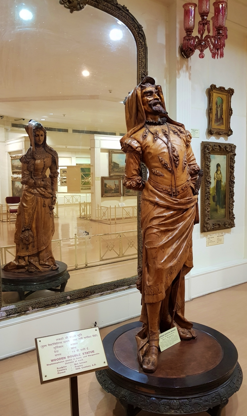 two-faced wooden sculpture at salar jung museum