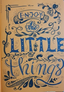 elaborate lettering with the quote enjoy the little things