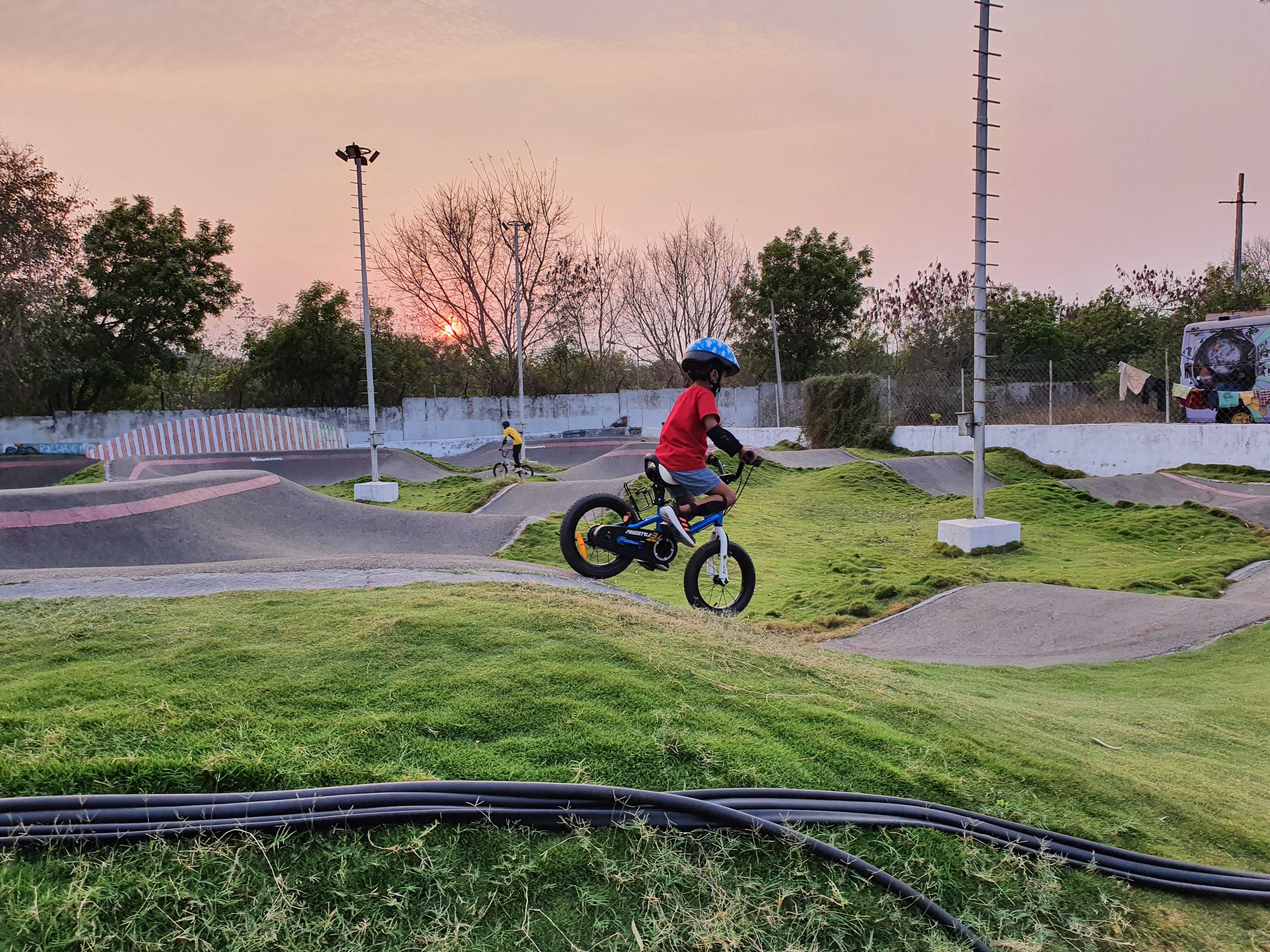 child riding a cycle on a pump track