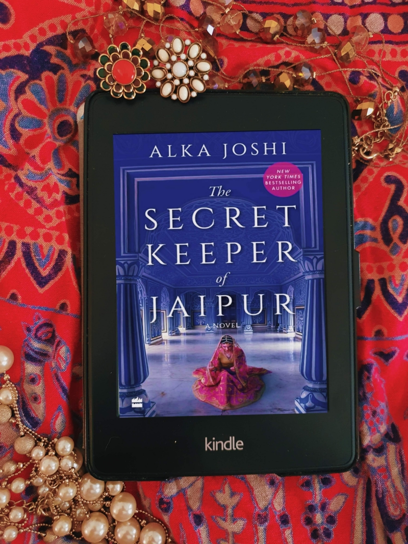 Kindle paperwhite with the cover of the secret keeper of jaipur